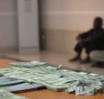 NSS detains two over counterfeit dollars